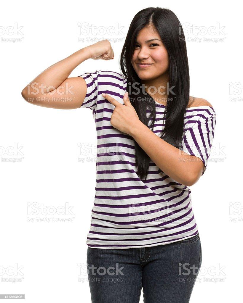 Confident Young Woman Flexes Bicep stock photo