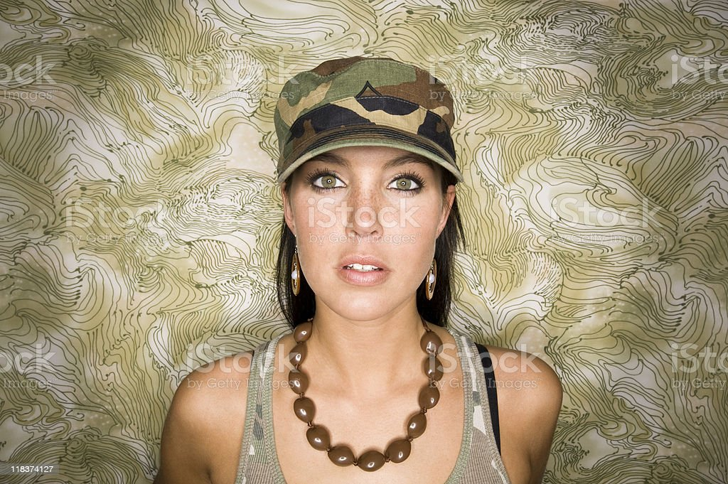 Confident Young Woman in Camo stock photo