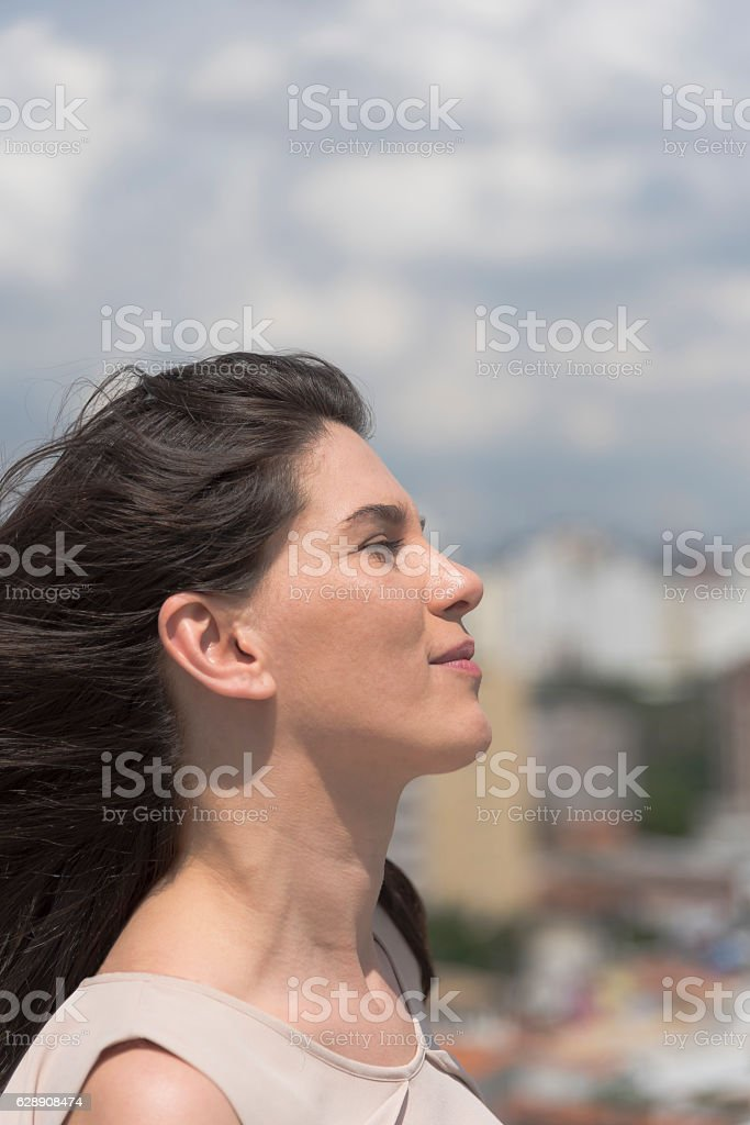 Confident young woman in the sun stock photo