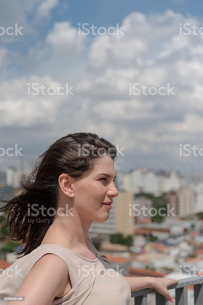 Confident young woman looking ahead stock photo