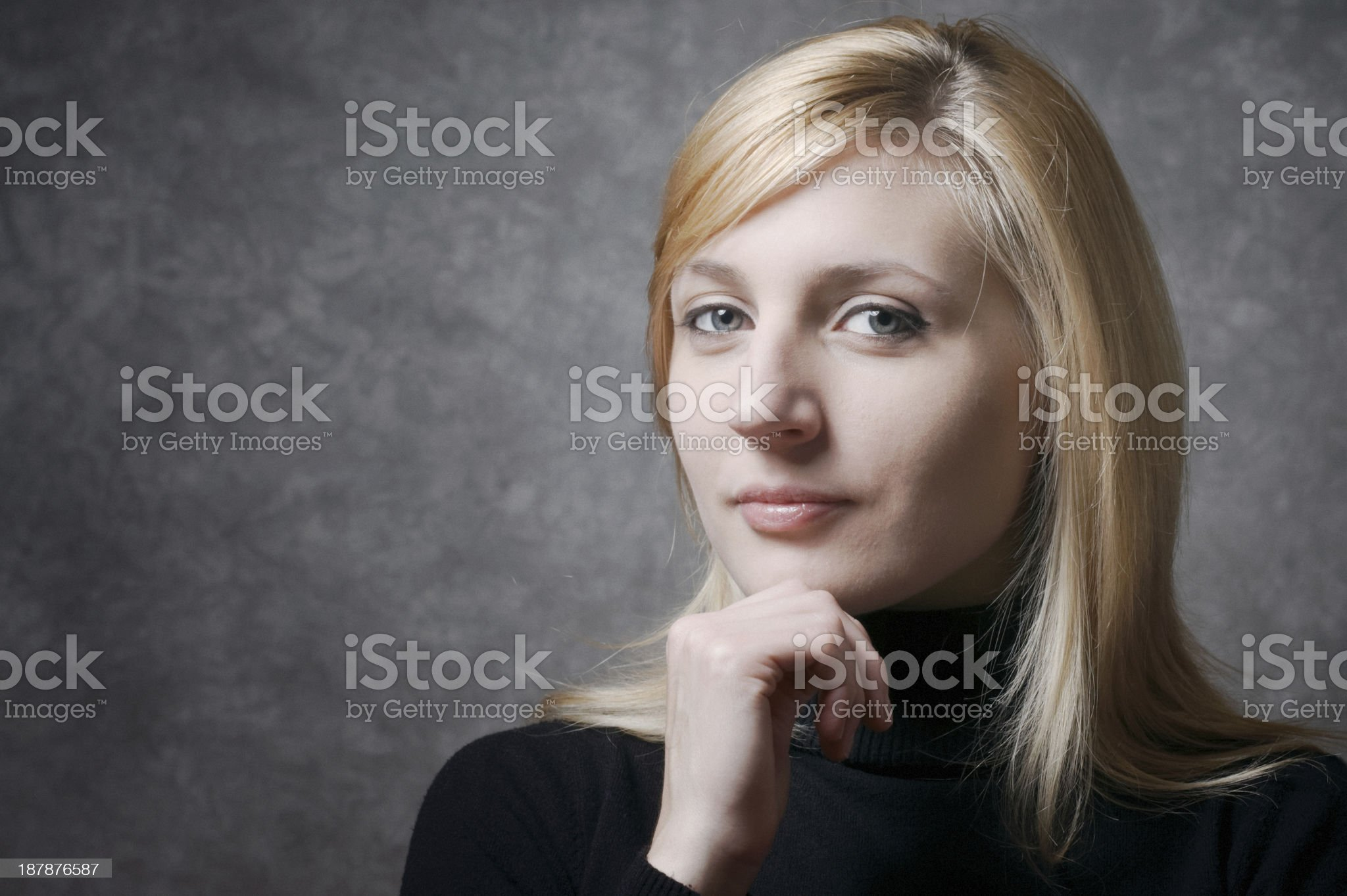 Confident young woman looking at camera royalty-free stock photo