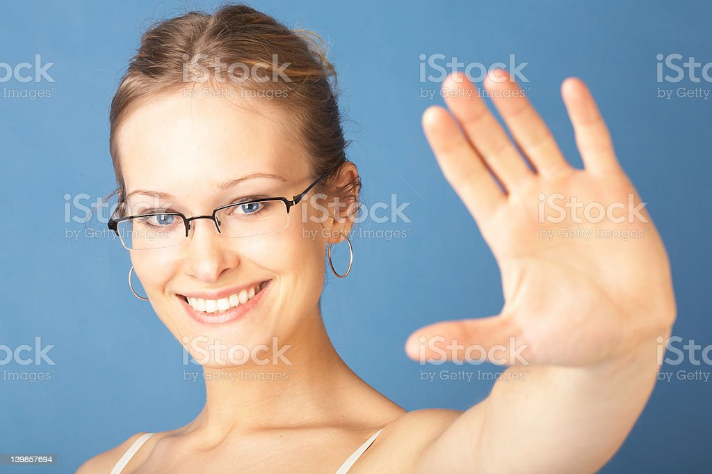 Confident young woman saying STOP royalty-free stock photo