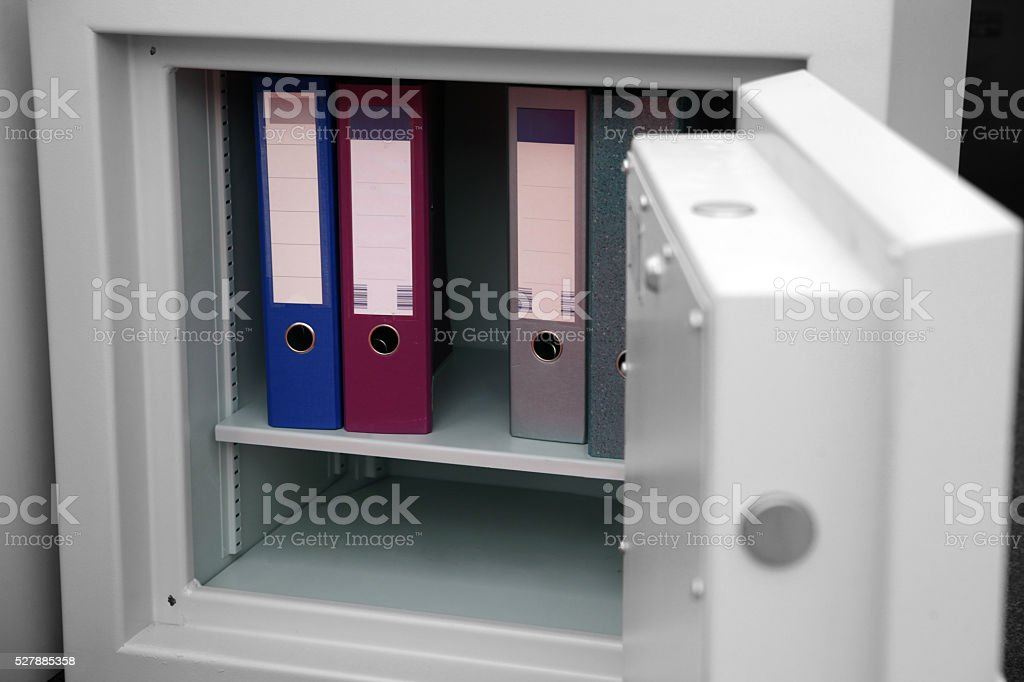 Confidential files in open safe stock photo