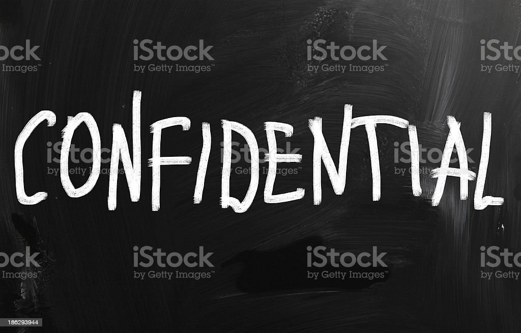 Confidential handwritten with white chalk on a blackboard stock photo