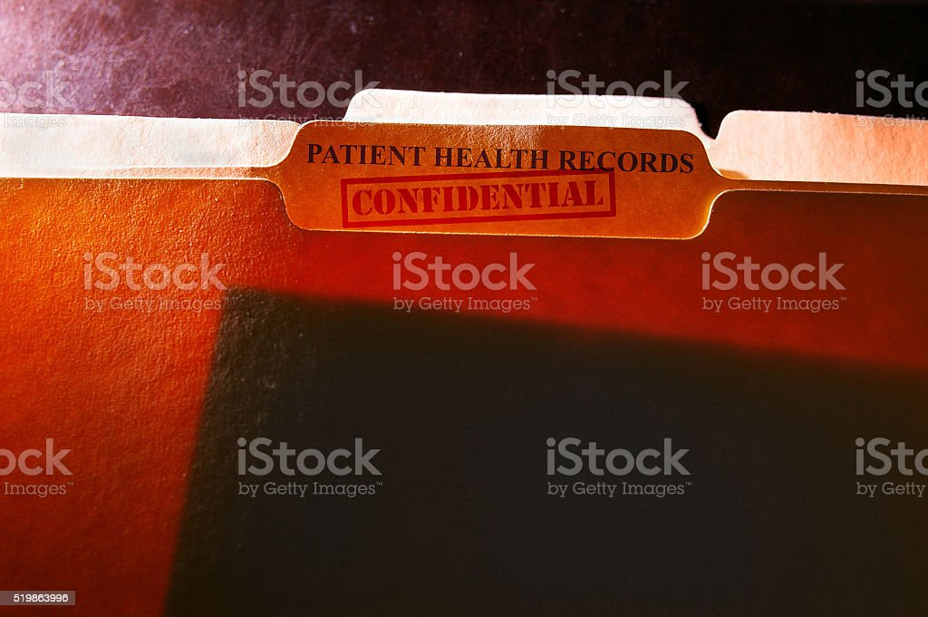 Confidential health records folders stock photo