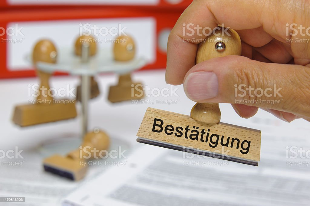 confirmation marked on rubber stamp - in german language: Bestaetigung royalty-free stock photo