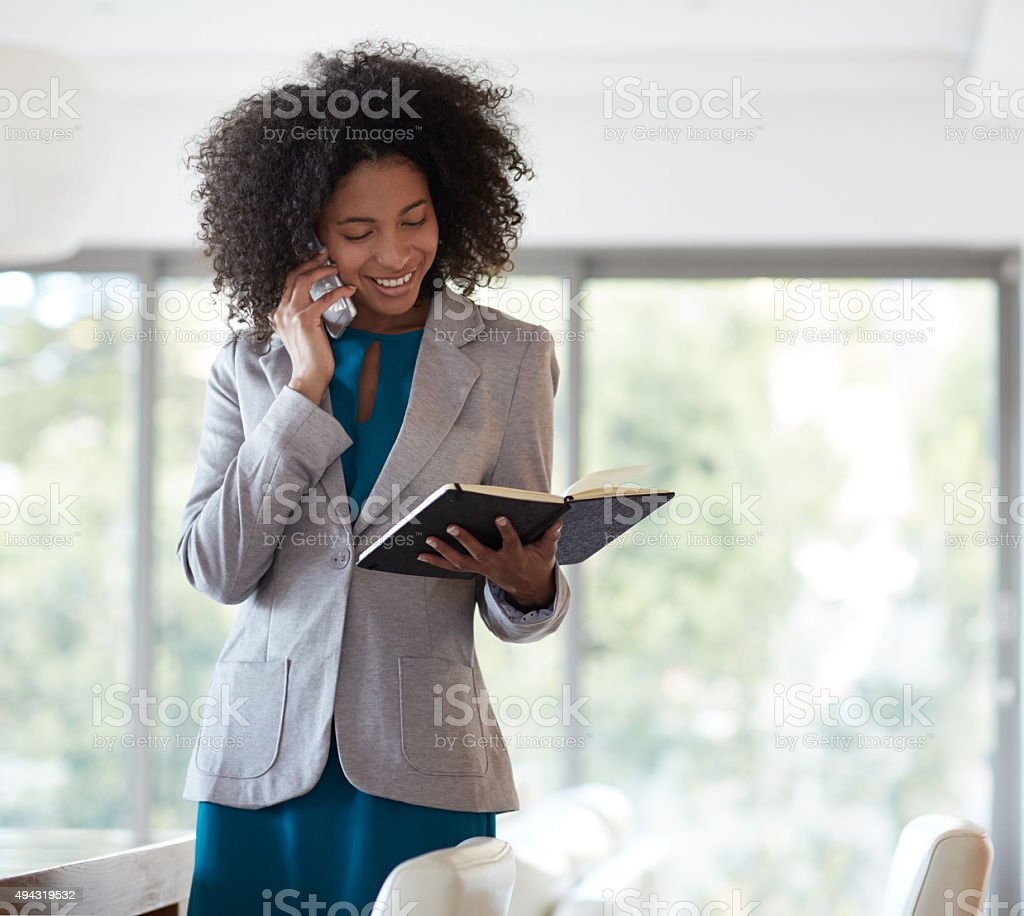Confirming her first appointment for the day stock photo