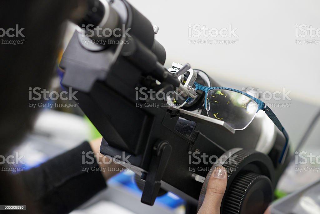 Confirming the prescription of the lens stock photo