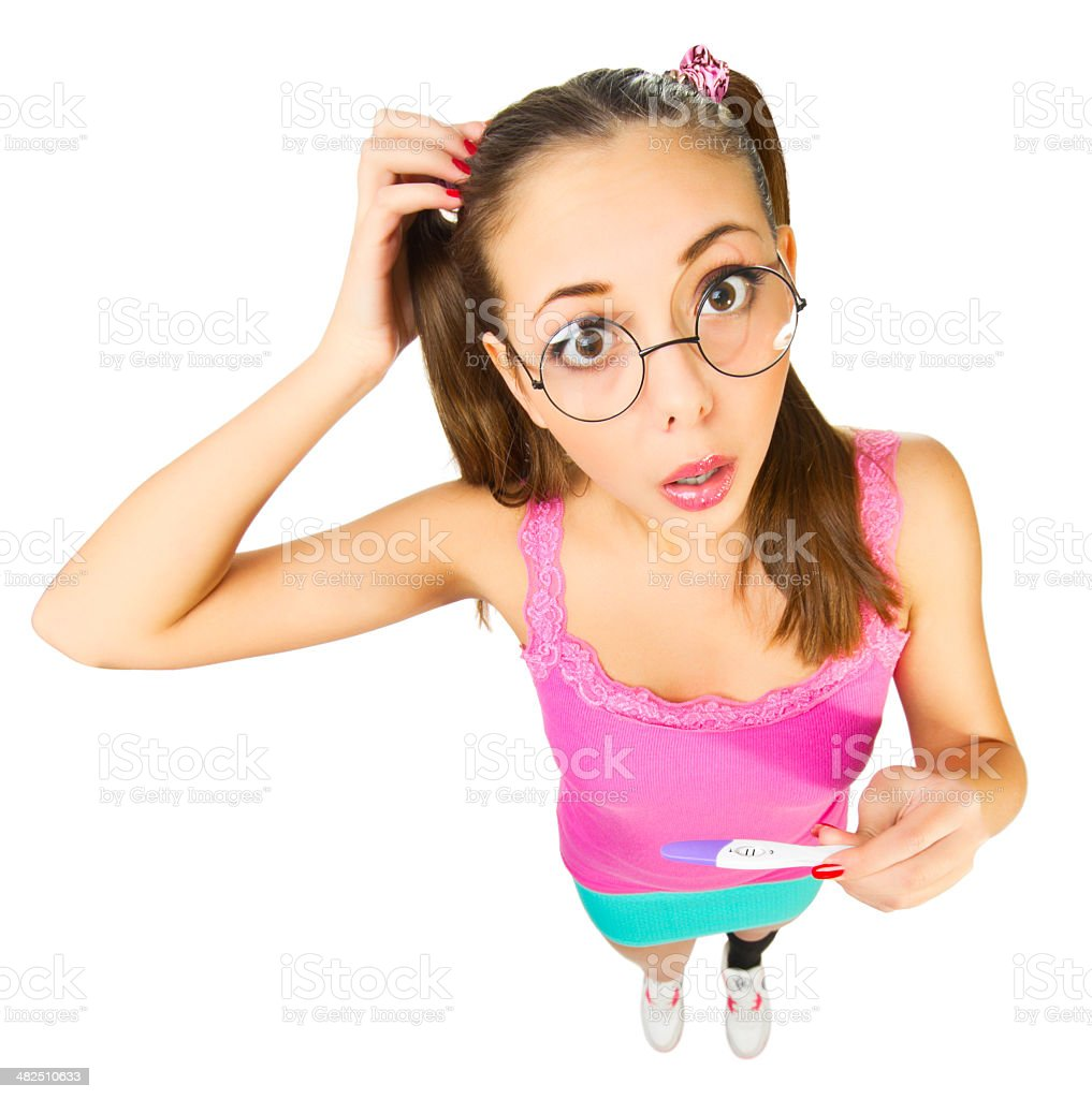 Confised schoolgirl with positive pregnancy test royalty-free stock photo