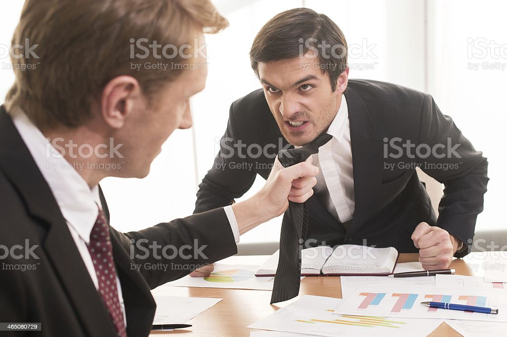 Conflict at working place. stock photo