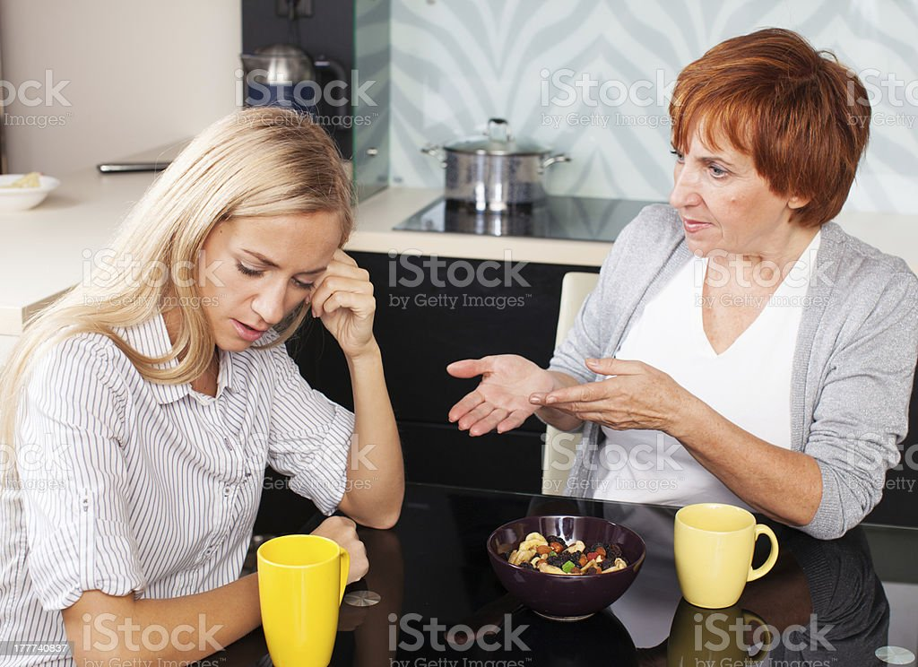Conflict between mother and daughter stock photo