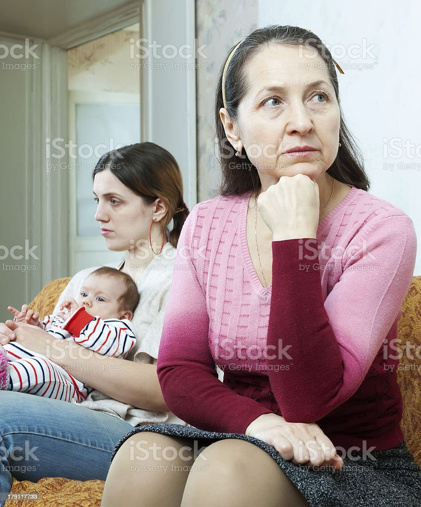 Conflict between the mature mother and daughter stock photo