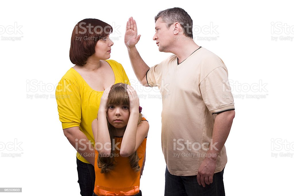 Conflict in a family. Husband is striking wife. royalty-free stock photo