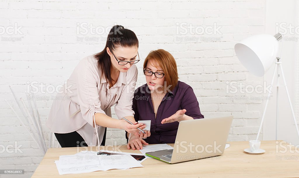 Conflict. Women discuss project in office stock photo