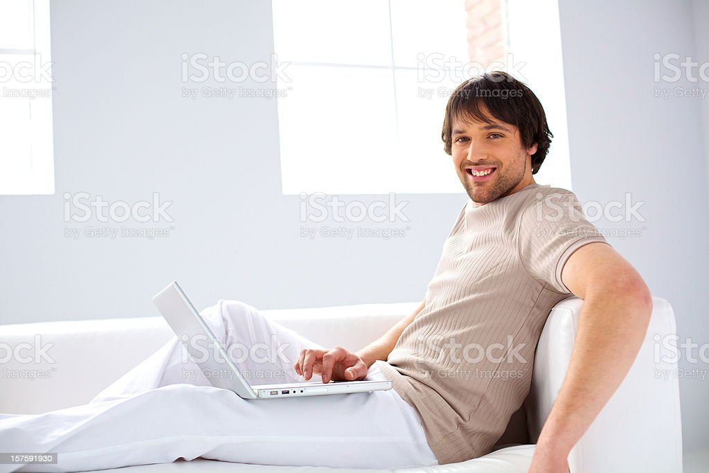 confortable freelancer working on a laptop royalty-free stock photo