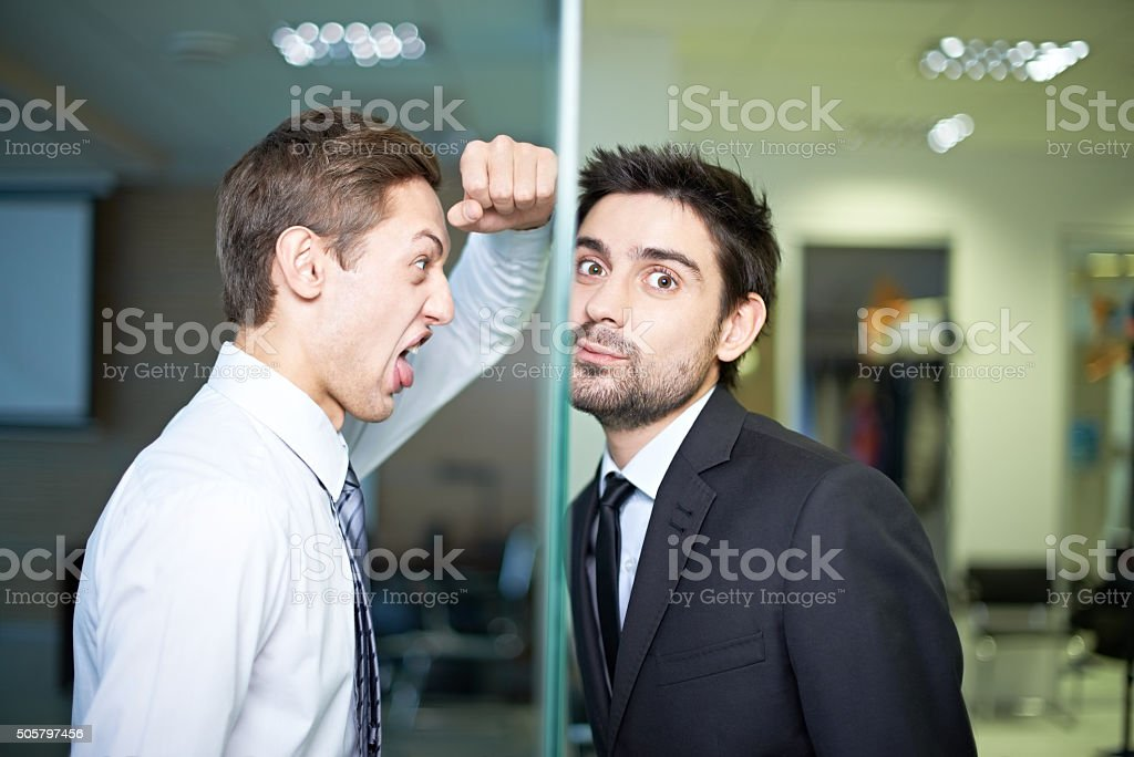 Confrontation at work stock photo