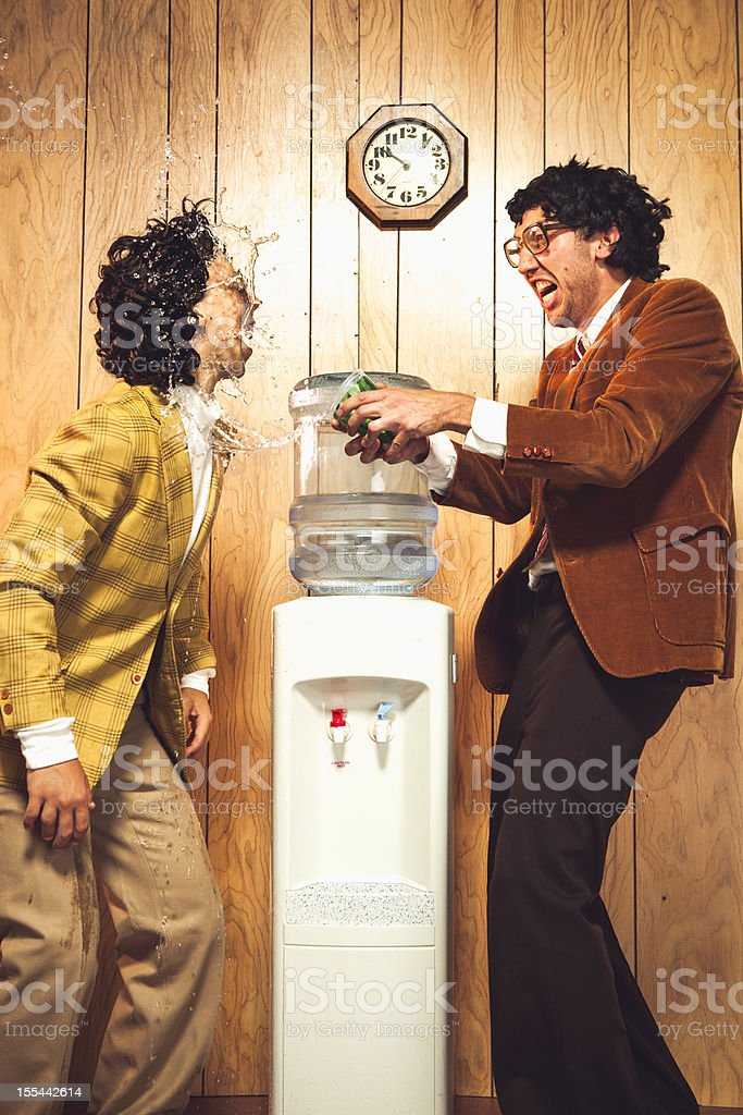 Confrontation by the Water Cooler Office Scene stock photo