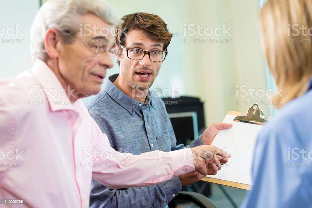 Confrontation in the office between boss and employees stock photo