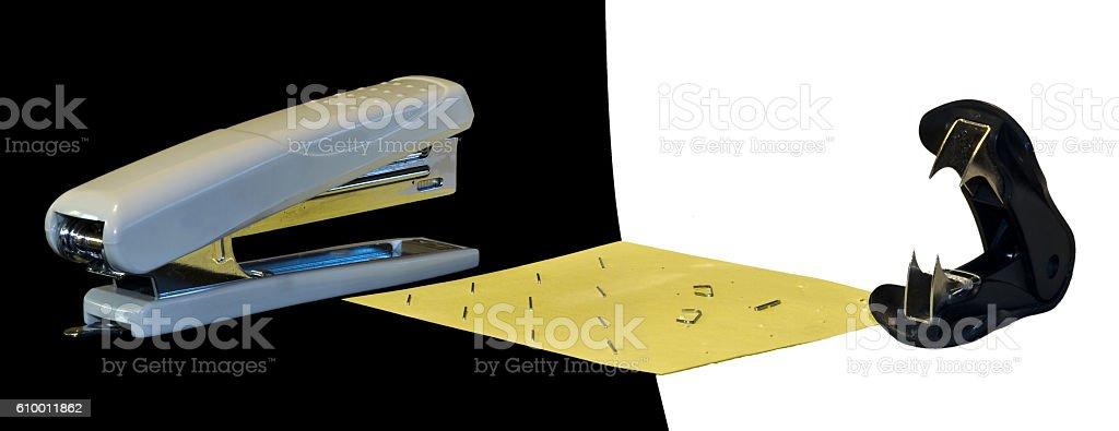 Confrontation stapler vs antistapler stock photo