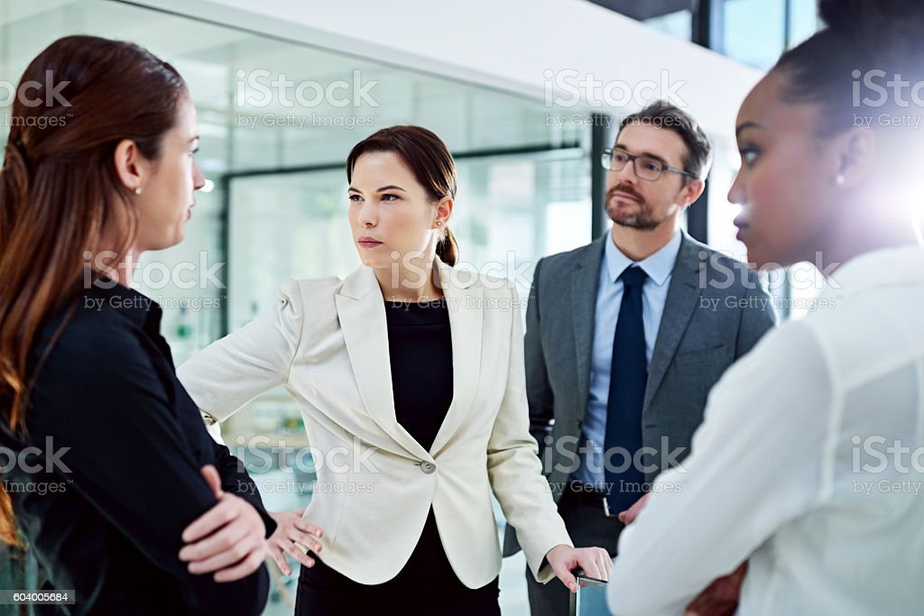 Confronting problems with colleagues is never a pleasant experience stock photo