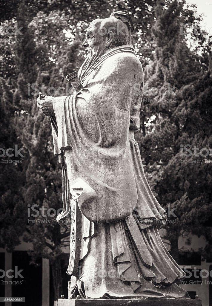 Confucius statue side view stock photo