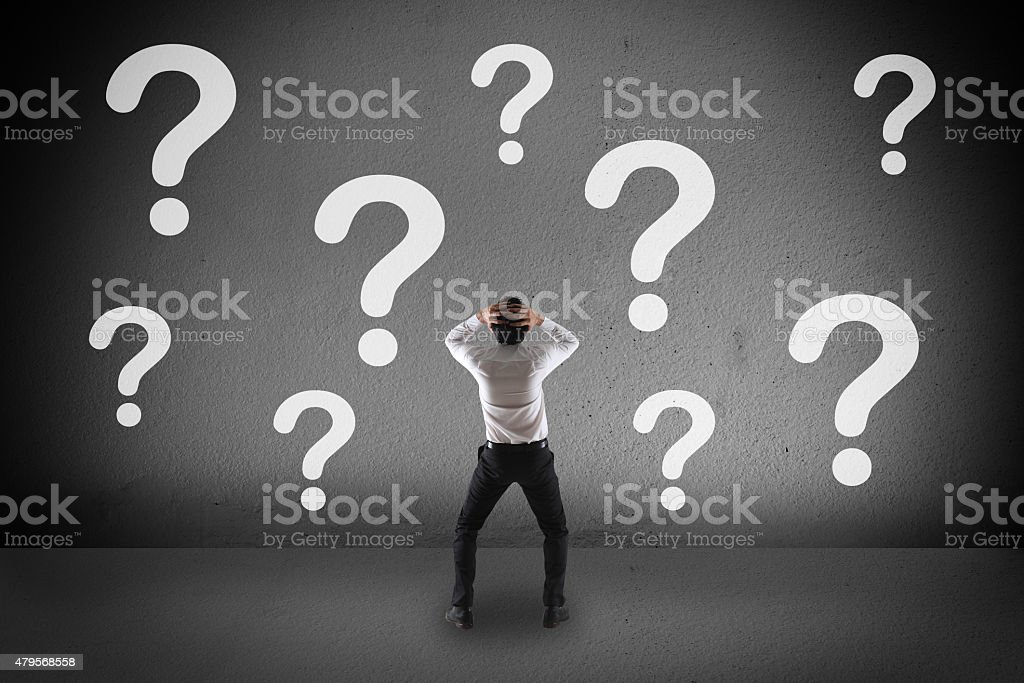 Confuse businessman and  question mark stock photo