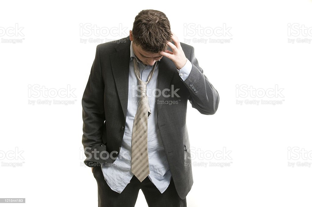 Confused and tired man in a suit isolated on white stock photo
