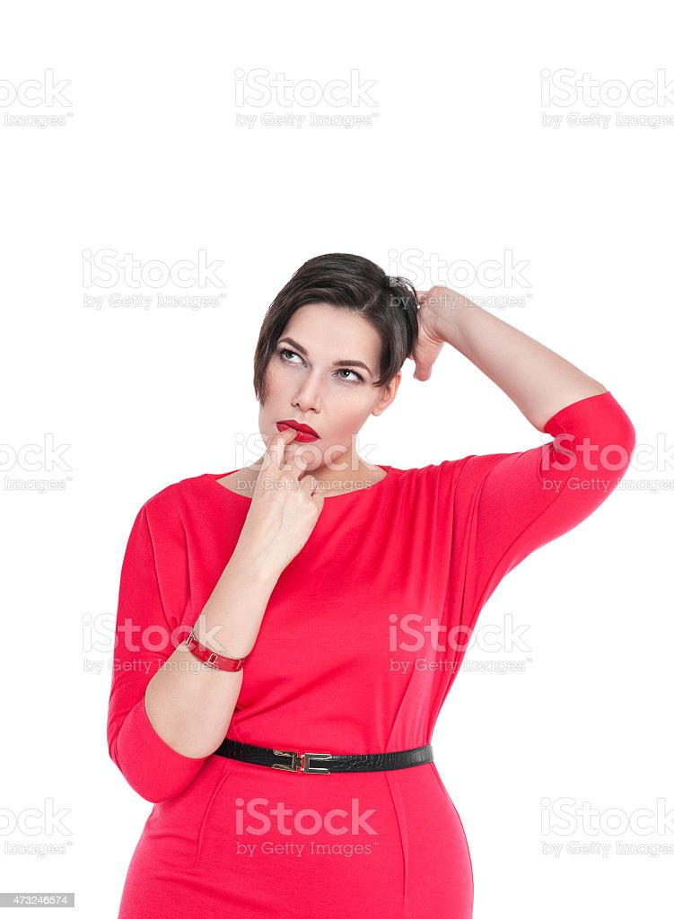 Confused beautiful plus size woman scratching her head isolated stock photo