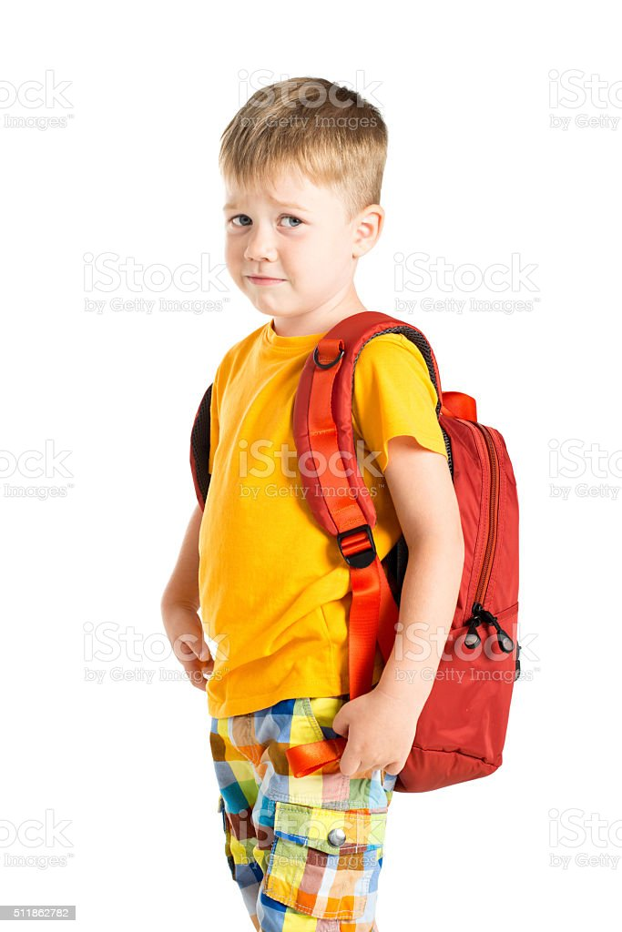 confused boy with backpack stock photo