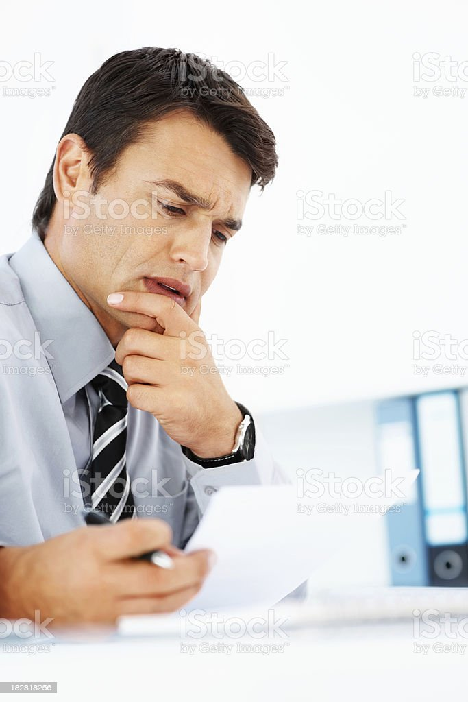 Confused business man reading a document royalty-free stock photo