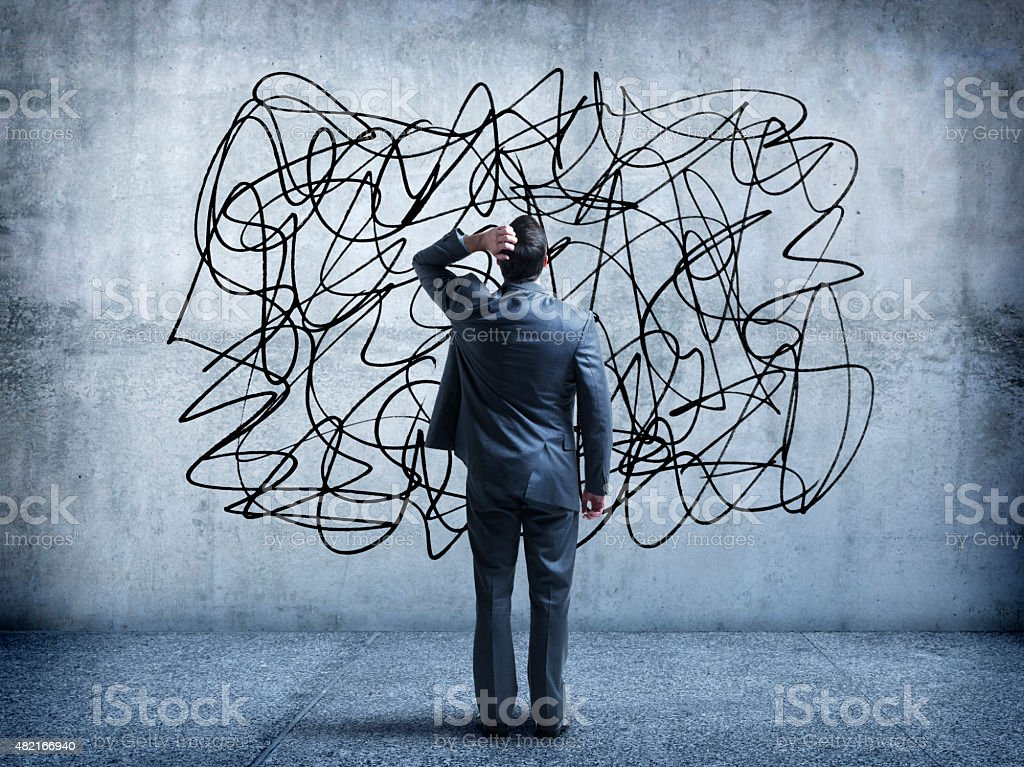 Confused Businessman Staring At Scribble On A Wall stock photo