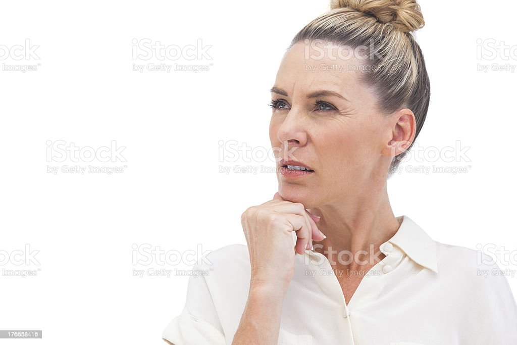 Confused businesswoman looking away royalty-free stock photo