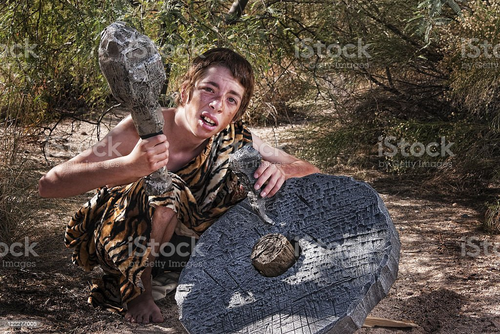 Confused Cave Boy stock photo