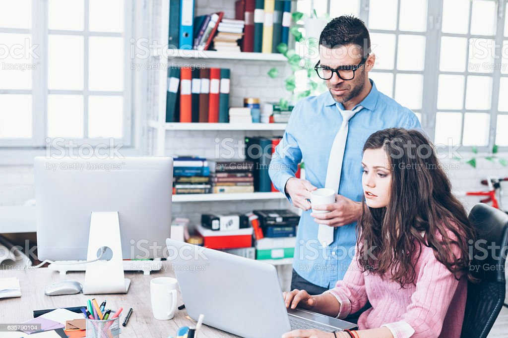 Confused coworkers having problems in workplace stock photo