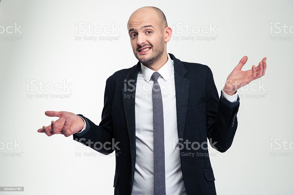 Confused embarrassed young businessman holding copyspace on both palms stock photo