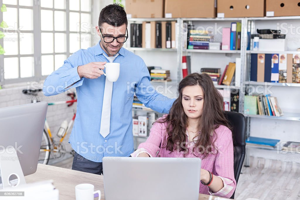 Confused female assistant having problems in workplace stock photo