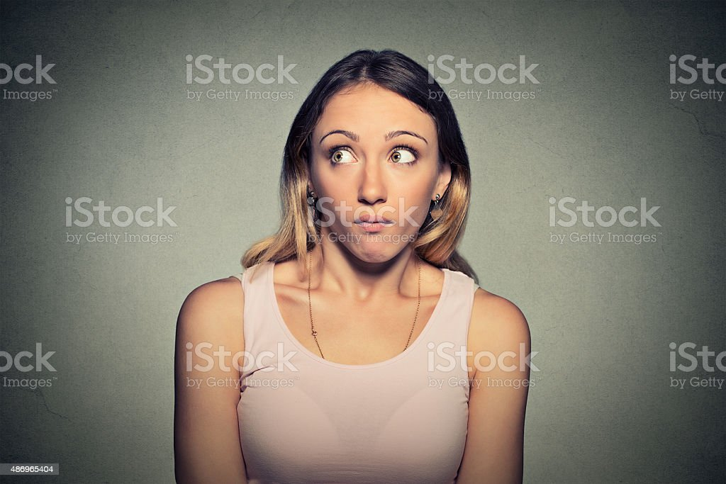 Confused guilty looking woman stock photo