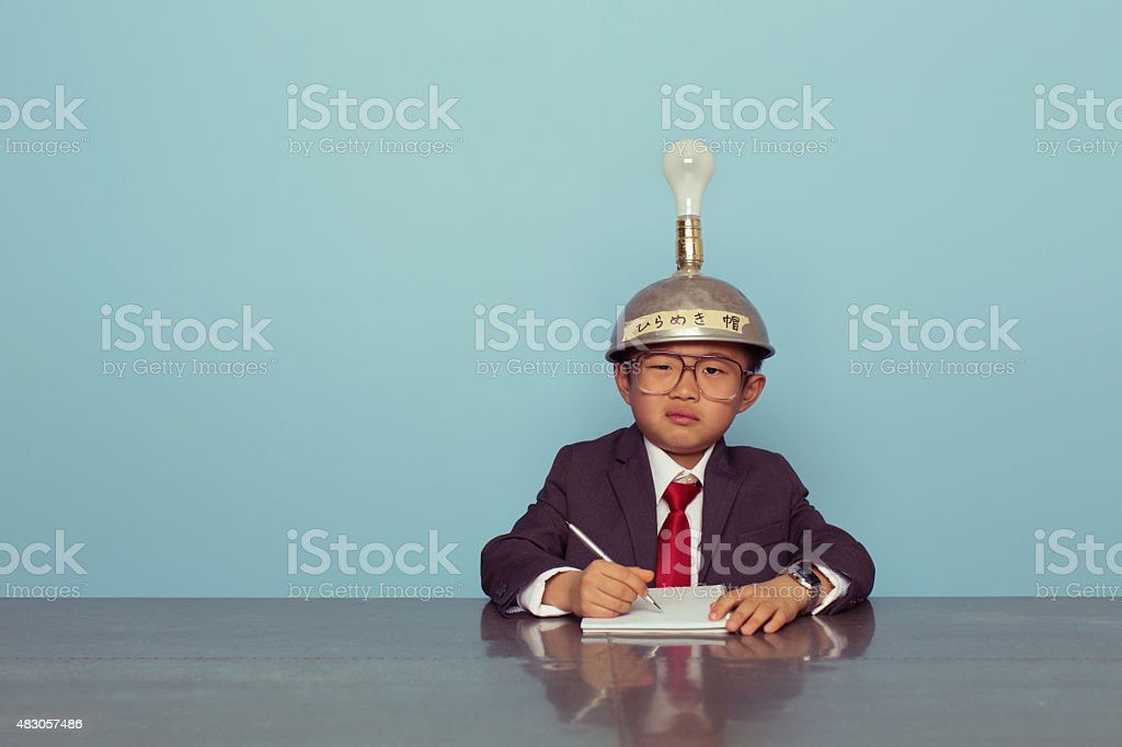 Confused Japanese Business Boy Wearing Thinking Cap stock photo