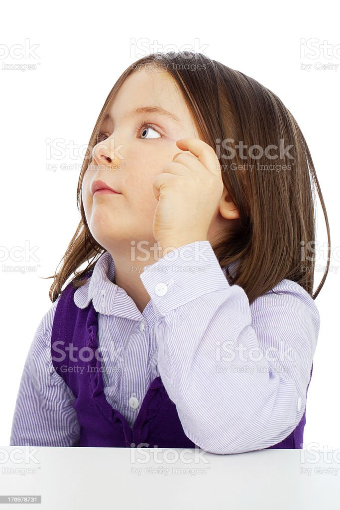 Confused little girl on white - close up royalty-free stock photo