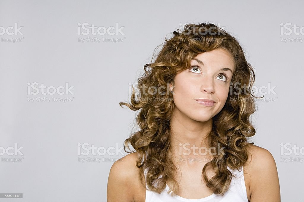 Confused looking woman stock photo