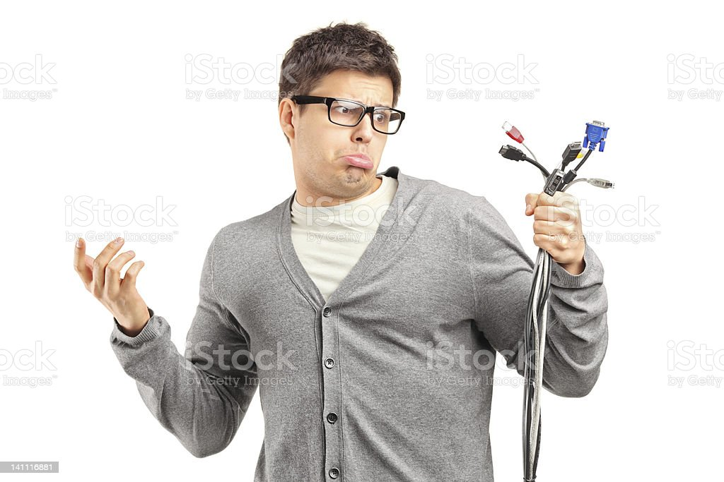 Confused male holding electronic cables royalty-free stock photo