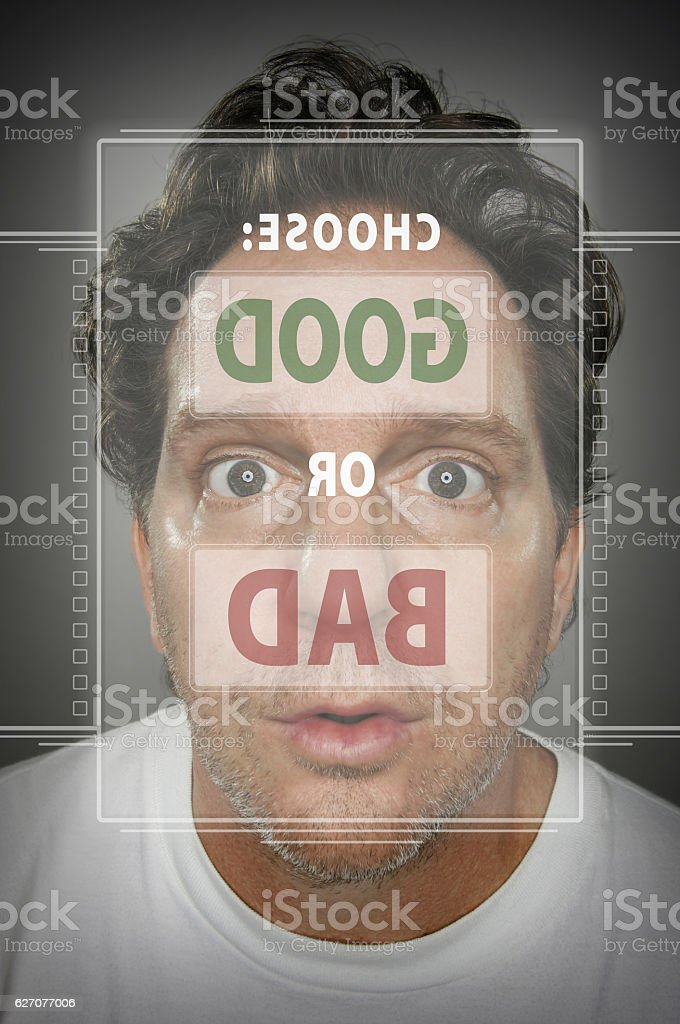 Confused Man at Touch Screen Choosing Good or Bad stock photo