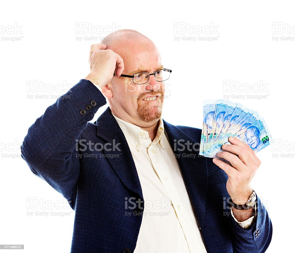 Confused man eyes new South African Hundred Rand banknotes royalty-free stock photo