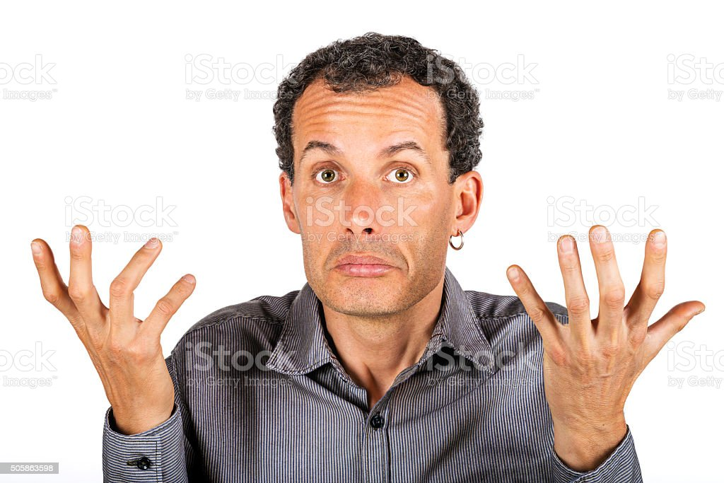 confused man giving I don't know gesture stock photo