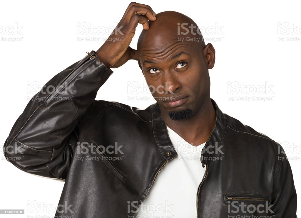 Confused Man Scratching Head royalty-free stock photo