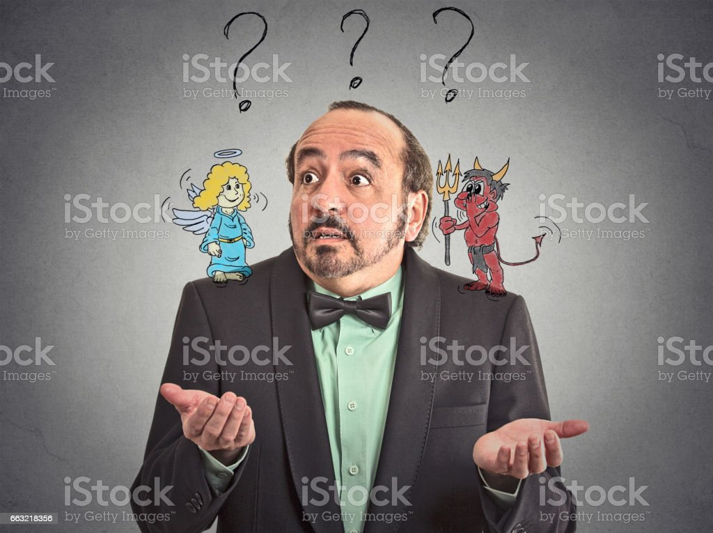 Confused man with angel and devil on his shoulders uncertain what choice to make stock photo