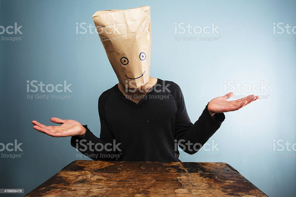 Confused man with bag over head royalty-free stock photo
