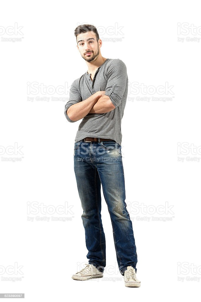 Confused man with crossed arms. stock photo