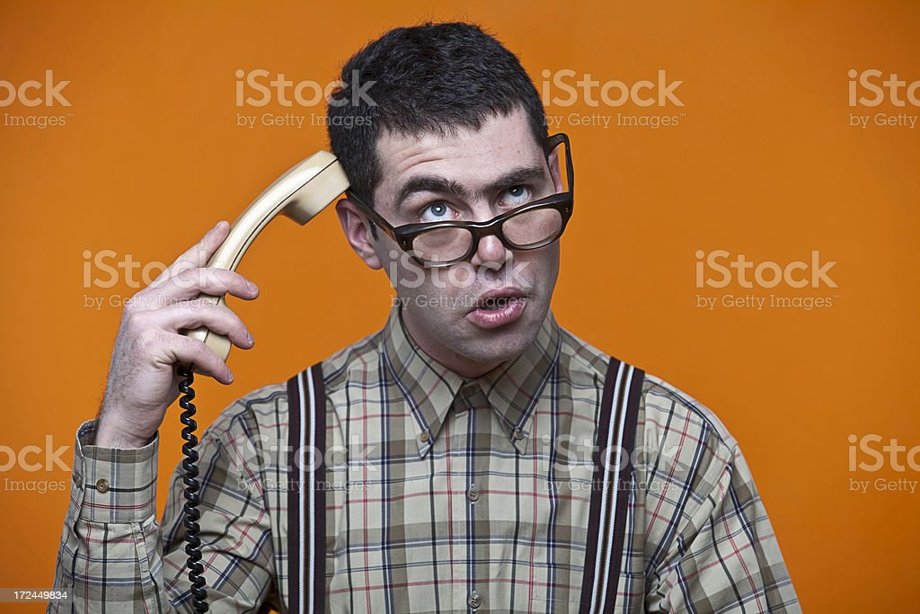 confused nerd on the phone royalty-free stock photo