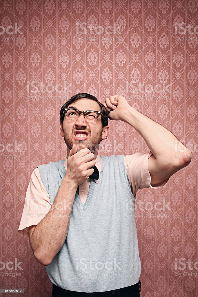 Confused Nerd Student Trying To Solve A Problem royalty-free stock photo